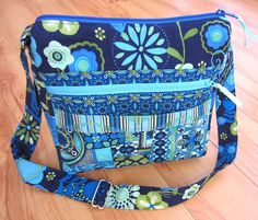 My Easy Going Purse Pattern by My Funny Buddy Sew your own crossbody style bag with fabulous results. I designed this bag for myself and use it every day. I wanted a casual yet useful purse to carry essentials but remain lightweight. The adjustable strap is perfect for wearing crossbody or over one shoulder. Front zipper pocket fits a large phone. Second outside pouch pocket for glasses, tissue, lip balm. Inside pocket is split in sections for pen, small pad of paper and a pleated pocket…
