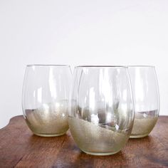 Transform dollar-store tumblers into something so chic with the help of rubber bands and a bit of glitter. Along with being wonderfully sparkly, these glasses are dishwasher safe and can be used for enjoying wine, your favorite cocktail, or even as candleholders.