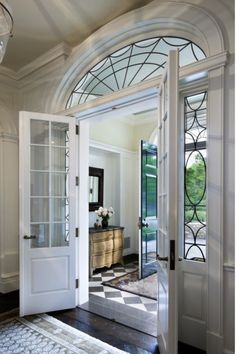 Foyer on Lake Michigan by Robert Stern. Architectural Digest. Love the French doors & windows.