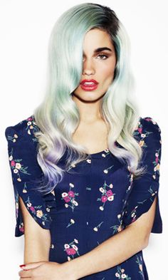 Mimi Wade's silky pastel green hair with lilac dip-dyed ends, lush waves and a side parting with dark roots.