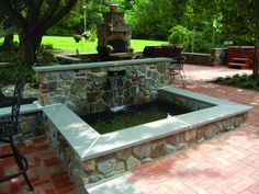 A way to incorporate Curt's idea of a retaining wall blocking the neighbor.   Stone Pond - Home and Garden Design Idea's