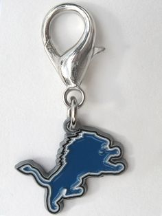 Officially Licensed NFL Team Charms Perfect gift for four-legged fans of the Detroit Lions! These jewelry-quality charms are crafted from antiqued, lead-safe pewter, and are hand- enameled.   Size: 1 x 1 3/4 in.   Made in the USA