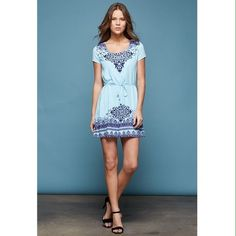 Dress with intricate design Bust: 18.5 inches armpit to armpit. Length: 34 inches from the top of the shoulders to the hem. 100% polyester.  Also available in Small and Medium. Dresses