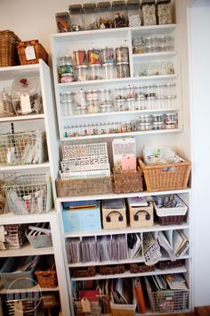 open baskets  and stacked jars for embellishment storage
