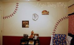 The room is already painted with a burgendy accent wall and the other walls are beige, I really like these baseball stiches. They are wall decals.