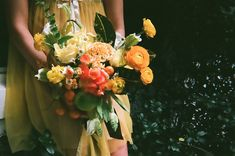 via: An Apple a Day. spring yellow and orange flowers and citrus.