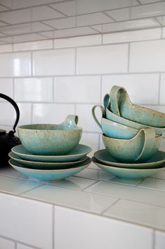 My gran has a bowl like these, I always loved how the blue glaze pooled  in the centre of the bowl and left the lovely speckled pottery beneath. Lovely.