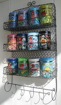 """They may not be super cheap, but if you want to """"spice"""" up your kitchen with some color, these 12 handpainted Kashmiri Spice Tins and rack could be just the ticket. About $214 plus shipping from NotOnTheHighStreet.com"""