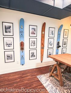 Ugly basement makeover ideas -- painted basement ceiling with water skis and black and white collage in manly basement decor office space #basementdecor #paintedbasementceiling #basementmakeover #finishedbasement #mancave #manhomeoffice #ralphlaurendesk #blackandwhitecollage #waterski #decor #interiordesign #decoratingideas