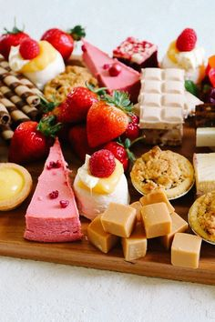 A dessert charcuterie board is a new trend to serve your guests a variaty of sweet treats- chocolate, strawberries, and candies. #dessert #charcuterieboard #deliciousfood