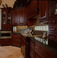 Cherry Wood Cabinets And Dark Granite Tops