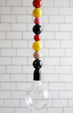 Made using a strand of multicolored wooden beads, Lightlace is pure lighting perfection for a kid's room. Luminaria Diy, Diy Luminaire, Ideas Prácticas, Decoration Originale, Decoration Inspiration, Home And Deco, Home Lighting, Nursery Lighting, Lampshades