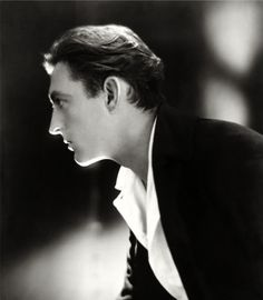 John Barrymore; played the title role in a 1922 silent movie version of Sherlock Holmes