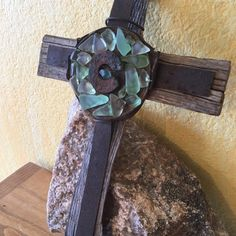 Rustic Wall Cross with beautiful Pieces of Desert Sea Glass around the Center. A unique one of a kind cross. Each cross is a one of a kind. No body shall have one like the one you choose. Perfect for a house warming gift, Christian home, cross collector Rustic Cross, Cross Art, Glass Center, Repurposed Wood, Wood Crosses, Rustic Wall Decor, Metal Bands, Sea Glass, Crates