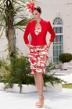 Here is a mother of the bride dress that is perfect for the Spring season.  This red long sleeve jacket is covering a pretty printed fabric skirt.  We can recreate this look for you in any colors or fabrics you like.  Contact our dress design firm for more details on custom #motherofthebridedresses as well as other formal wear designs for he wedding at www.dariuscordell.com