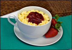 Eggs in Mugs! 3/4 egg substitute, 1 wedge laughing cow cheese, 1 tbsp low sugar strawberry preserves, 150 cal, microwave egg 1 1/2 min, add cheese and microwave 1 min more