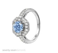 'Bourbon' ring set with a blue diamond. This ring has a millgrained edge detail and a Asscher shaped surround for a vintage feel.