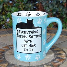 """Everything Tastes Better With Cat Hair In It"", mug - Out of Stock - UpstartCrowTrading.com   (08.18.14)"