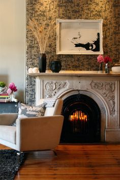 Interesting and unique fire place design - like the stone up the wall and the detail on the face -   Stone Fire Place