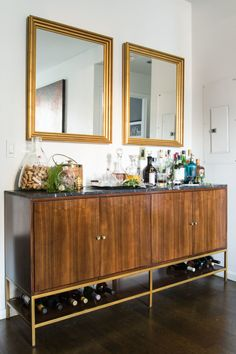 The beautifully polished wood bar cabinet is topped with granite. It was a find from Safavieh.