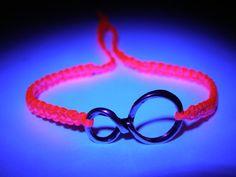 Infinity Bracelet with fluorecent pink nylon thread. kr55,00/$9.49, via Etsy.