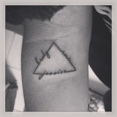 Triangle tattoo of my two siblings names and mine