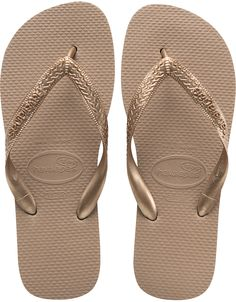 The Top Metallic adds eye-catching appeal to your look with a metallic strap. A tonal Havaianas logo and our signature textured footbed provide style and comfort. Thong style Cushioned footbed with textured rice pattern and rubber flip flop sole Made in Brazil