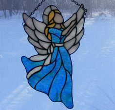 "Stained Glass Angel - 11"" Tall - Joy - Blue and Green Swirl. $85.00, via Etsy."