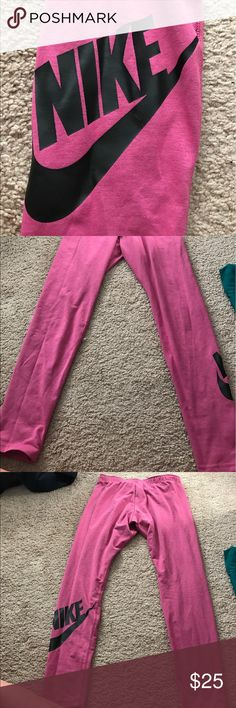 "NIKE fuchsia leggings. size L fuchsia cotton nike leggings, with large black NIKE logo on back of right leg. rear waistbad has ""Just Do It"" printed on the back and can be seen when rolled down. Never worn. Nike Pants Leggings"