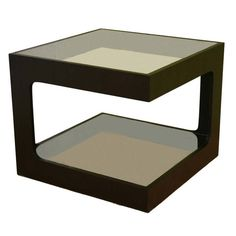 Our professional-looking contemporary coffee table offers dual tempered glass surfaces for storage and display.