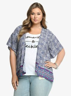 """This tile-print kimono has us all smiles. It's a lightweight challis with a pretty globally-inspired pattern in blue, pink, and turquoise. Split side seams and short dolman sleeves give this cool cover-up a contemporary feel.<br><br><b>Model is 5'11"""", size 1</b>"""
