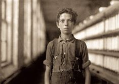 """Employee of the Week: May Burlington, Vermont. """"Jo Bodeon, a 'back-roper' in the mule room, Chace Cotton Mill."""" More accurately known as Joseph Beaudoine last glimpsed here. Gelatin silver print by Lewis Wickes Hine Vintage Photographs, Vintage Photos, Joseph, Lewis Hine, Cotton Mill, Classic Photography, Gelatin Silver Print, High Resolution Photos, Photo Archive"""
