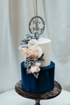 Blue Is The Wedding Color Scheme You'll Never Regret Impress guests with a stunning two=tier color-blocked wedding cake.Impress guests with a stunning two=tier color-blocked wedding cake. Navy Blue Wedding Cakes, Blue Wedding Decorations, Purple Wedding, Wedding Cake Two Tier, Floral Wedding, Blue Weddings, Two Tier Cake, Gold Wedding, Wedding Flowers