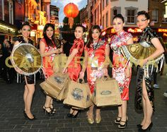 CHINESE HOSTESSES take part in the World of Warcraft: Mists of Pandaria Live Stream Release handing out goodies to the crows and helping with the event inside on the world stage. Tel: 020 3602 9540 UK ENTERTAINMENT AGENCY spreading Chinese Lion Dance luck for everyone across MANCHESTER, STAFFORDSHIRE, BIRMINGHAM, BRISTOL, BRIGHTON & LONDON Tel: 020 3602 9540  http://www.calmerkarma.org.uk/Chinese-Themed-party-entertainment.htm