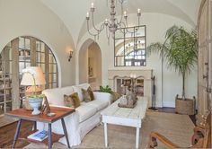 Arched pocketed doors between kitchen and family room.  Cote de Texas.
