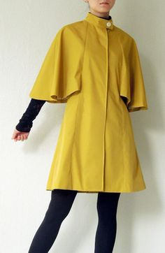Share with:Cape coat with stand collar Simple and clean princess seams make beautiful A-line 2 pockets on the both sides Including lining pattern.