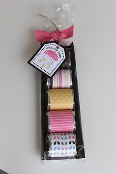 Hershey Nugget Tray - baby shower favor: wrap each nugget in a 1-inch by 3-inch piece of designer paper. The tray begins with a 2.25 x 5.5 card stock. Score at 1/2-inch down each long side. Put in a clear wilton's pretzel bag.