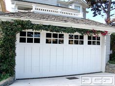 Traditional Carriage House Garage Doors combined with modern functionality of automatic overhead garage door systems have made this style a coastal favorite. This custom wood garage door offers traditional design with its top window panel and fine craftsman style. As a traditional norm this garage door was given a high quality coat of white. Although …