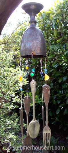 Earth Day in the Garden from a Recycling Artist's Perspective..The chime is fashioned out of an old anniversary cup found at a garage sale and hung with flattened silver cutlery is another recycled artwork