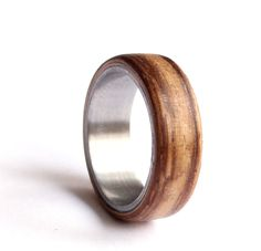 Mens Wedding Ring, Titanium Ring, Stainless Steel Wedding Band, Zebrano Wood Wedding Ring, by agatechristina on Etsy https://www.etsy.com/listing/277838324/mens-wedding-ring-titanium-ring