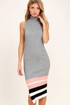 Make the most of the day by setting out in the Obey Marina Grey Striped Midi Sweater Dress! Soft and stretchy ribbed knit forms a mock neck, and sleeveless, bodycon bodice. Midi skirt features black, peach, and white stripes as well as a sultry, side slit. Logo tag at hem.