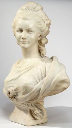 An Italian School Carrara Marble Sculpture ~ Figural bust of a female ~ A rose to the center of her chest ~ and a wrap around her shoulders ~ Origin Italy ~ Circa 1875-1925