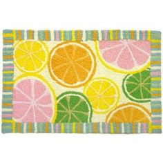Jellybean - Citrus Cool by Jellybean. $35.01. A great choice, indoors or out!. Machine Washable. Perfect for pet food areas, or under litter boxes and water bowls.. Never fades in sunlight.. Stands up to heat and cold.. Add a punch of color and fun to your outdoors or indoors with these great rugs from Home Comfort. The Jellybean Collection is handmade out of 50% polypropylene and 50% acrylic with polypropylene backing. 35% of the material in a JellybeanTM rug is recycled! E...