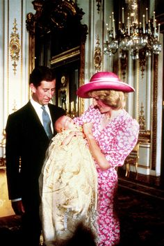 Princess Diana in pink with Prince Charles and Prince William in 1982