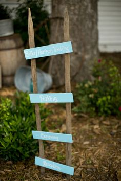 creative ladder sign pointing guests in the right direction  I thereddirtbride.com I see more of this wedding here