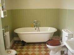 Architecture of Tiny Distinction: A Little Bathroom Takes Shape - wainscoting and flooring