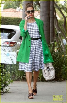 Eva Mendes in a Dolce&Gabbana coat and a New York & Company dress.