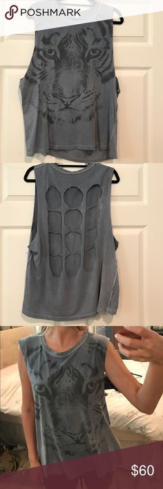 Open back tiger muscle tee Oversized muscle tee with unique open back and cool tiger print. Beautiful grayish-blue color. Super hip, soft, and chic. Only worn a couple times, in great condition. Super soft and comfy, 100% cotton. LF Tops