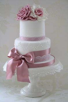 pink + white wedding cake by Cotton and Crumbs. love the white rose with a pink center.