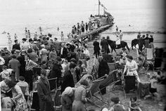 Portobello beach, Edinbugh, 1957.  NB Coats are required foe Edinburgh summers. Generally. (Copyright Scotsman Newspaper)